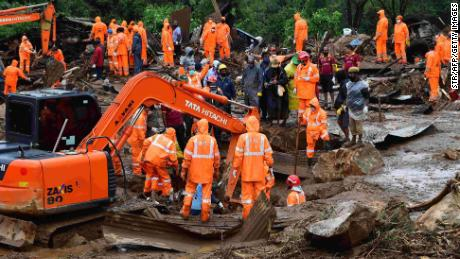 TOPSHOT - Rescue workers search for missing people at a landslide site caused by heavy rains in Pettimudy, in Kerala state, on August 8, 2020. (Photo by STR / AFP) (Photo by STR/AFP via Getty Images)