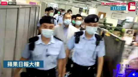 Officers raid the premises of the Apple Daily newspaper in Hong Kong on August 10, 2020.