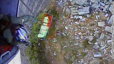 A Coast Guard helicopter crew successfully rescued the injured hiker on Sunday.