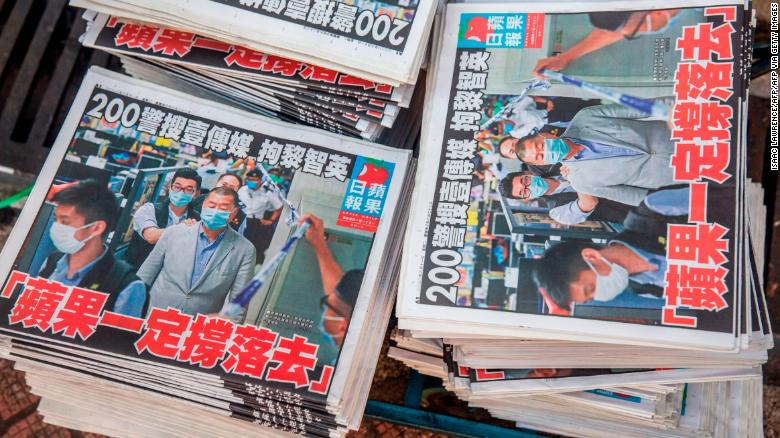 Copies of the Apple Daily newspaper - paid for by a collection of pro-democracy district councillors - sit on a cart before being handed out in Hong Kong on August 11, 2020.