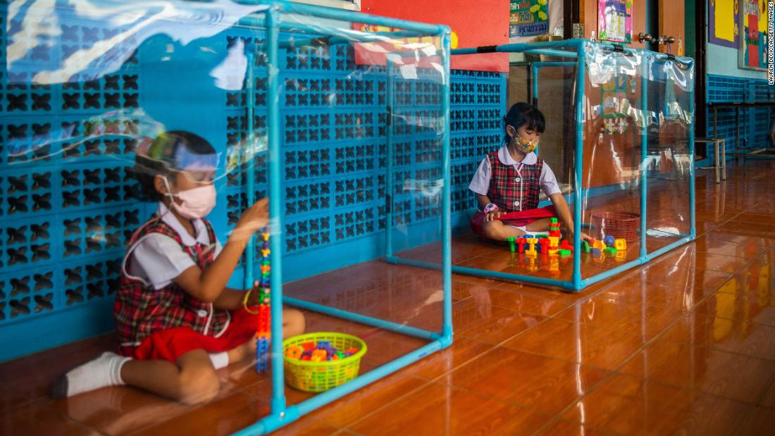 Kindergarten students wear face masks and play in screened-in areas at the Wat Khlong Toey School in Bangkok, Thailand, on August 10.