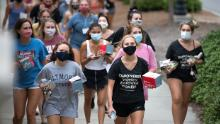 College students walk to dinner this week at the University of South Carolina in Columbia.