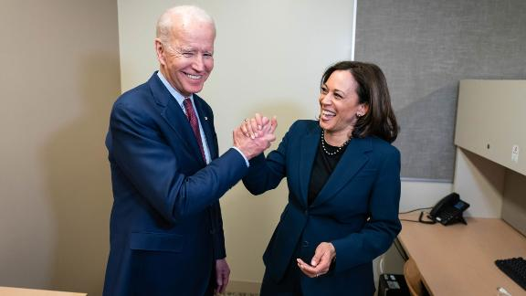 "Harris and Biden greet each other at a Detroit high school as they attend a ""Get Out the Vote"" event in March 2020. Harris had dropped out of the presidential race a few months earlier."