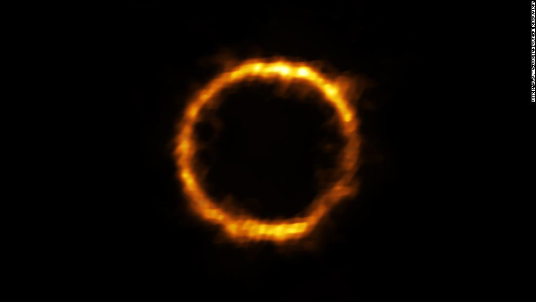 This extremely distant galaxy, which looks similar to our own Milky Way, appears like a ring of light.