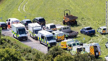 Emergency services attend the scene.