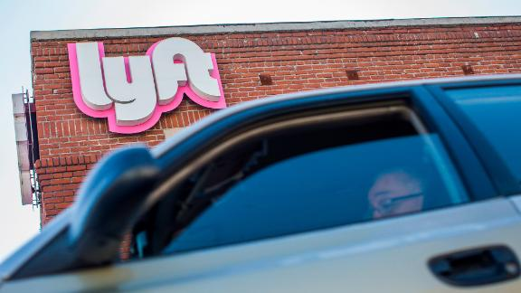 A driver rides his car in front of the Lyft Drivers Hub in Los Angeles, California, March 29, 2019. Ride-hailing company Lyft made its Initial Public Offering (IPO) on the Nasdaq Stock Market on March 29th. (Photo by Apu Gomes/AFP/Getty Images)