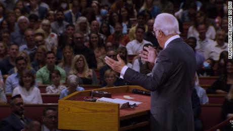 Pastor John MacArthur speaks during a July 26 service at Grace Community Church. CNN has blurred a portion of this image to protect a child's identity.
