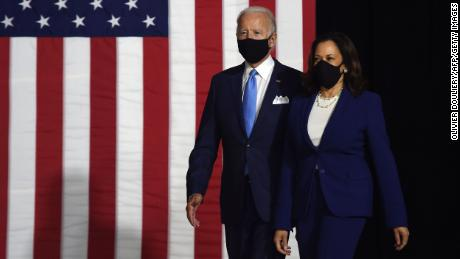 Joe Biden and Kamala Harris arrive at their first joint press conference on Wednesday wearing masks.