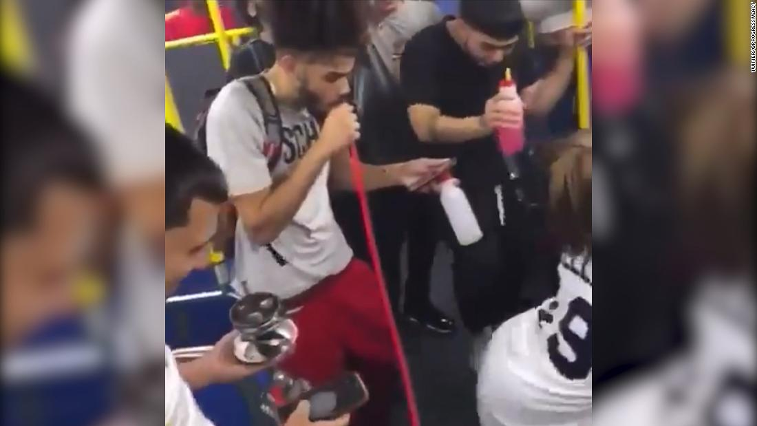 Group of unmasked people take over New York bus and hold party