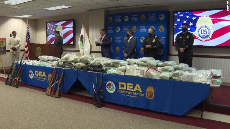 Authorities displayed the drugs, money and firearms that were seized on July 27.