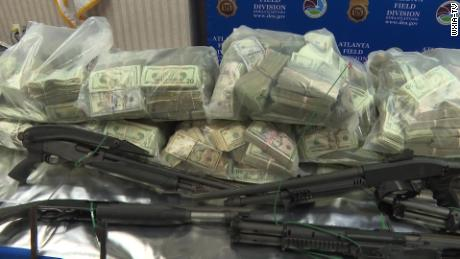 Money and firearms seized by the DEA.