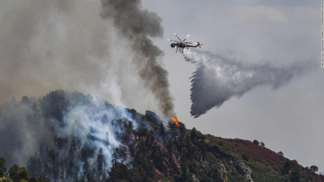 Fire crews work to battle the Grizzly Creek Fire near Glenwood Springs, Colorado, on Tuesday, August 11.
