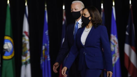 Democratic presidential nominee and former US Vice President Joe Biden (L) and vice presidential running mate, US Senator Kamala Harris, arrive to conduct their first press conference together in Wilmington, Delaware, on August 12, 2020. Photo by Olivier Douliery/AFP/Getty Images
