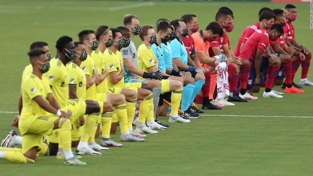 'Absolutely disgusting.' Soccer star criticizes booing of players kneeling during national anthem