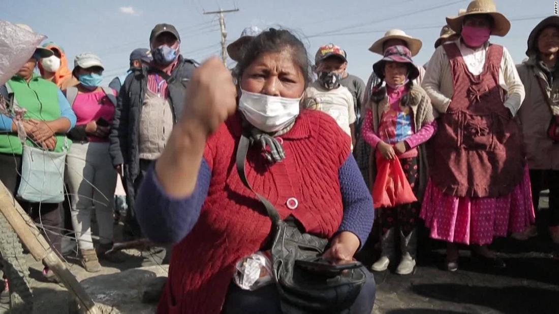 Protesters in Bolivia cry out as country is hit but dual pandemics