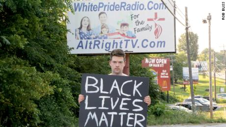 Flimmaker Rob Bliss stands in front of the controversial billboard in Harrison, Arkansas.