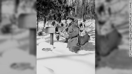 A postman in Scarsdale, New York in December of 1947.