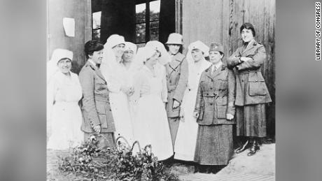 Staff of Military Unit of Women's Oversea Hospitals U.S.A. Nurses and Doctors left to right. Dr. Mary Lee Edwards. Mrs. Raymond Brown, in civilian dress in doorway. Dr. Caroline Finley. Dr. Anna Shally