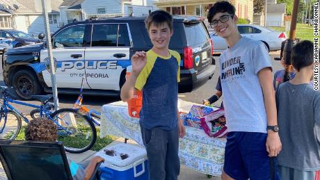 Jude, left, and Tristan, right, at their lemonade stand after they were robbed at gunpoint.
