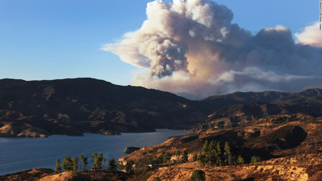 A plume of smoke rises from the Lake Fire on August 12.