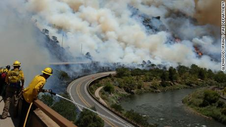 Firefighters battle the Grizzly Creek fire in Colorado on Monday, August 10.