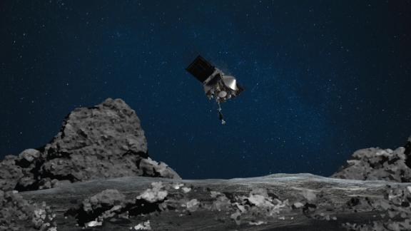 NASA's OSIRIS-REx touched down on asteroid Bennu on October 20. This illustration shows the spacecraft approaching the asteroid.