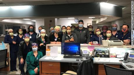 The ICU team at Mary Washington Hospital. Mason is in the front with the printed mask and yellow bouffant cap.