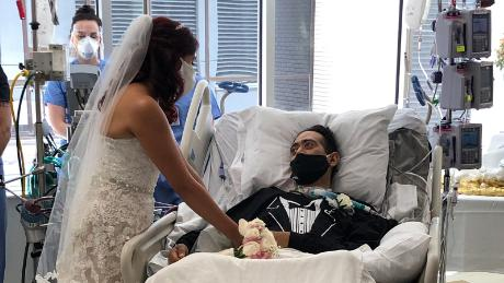 The happy couple was married and the weakened groom was still in his hospital bed.