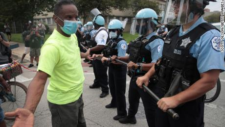 Police prevent demonstrators protesting police brutality from marching toward the freeway on August 15, 2020 in Chicago, Illinois.