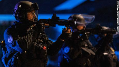 Portland police are seen in riot gear during a standoff with protesters in Portland, Oregon, on August 16, 2020.