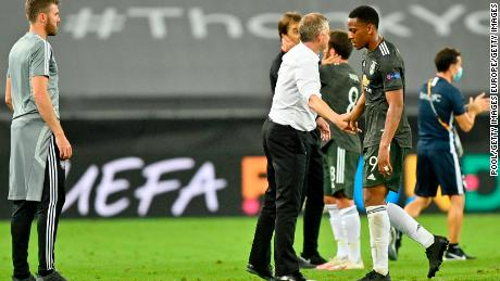 Solskjaer (second right) consoles Anthony Martial (right) after defeat to Sevilla.