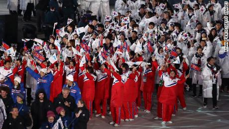 Team North Korea and Team South Korea walk together in the Parade of Athletes during the Closing Ceremony of the PyeongChang 2018 Winter Olympic Games.