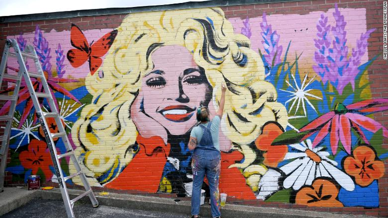 Artist Kim Radford's mural of country music star Dolly Parton on an exterior wall of The 5 Spot music venue in East Nashville.