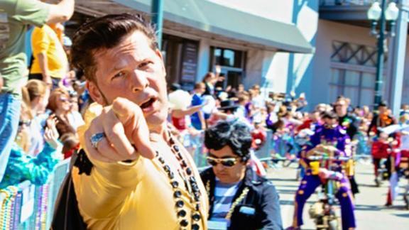 Ray Cannata, pastor of Redeemer Presbyterian Church, dressed up as Elvis Presley with his Elvi krewe at the Iris Parade during Mardis Gras season..