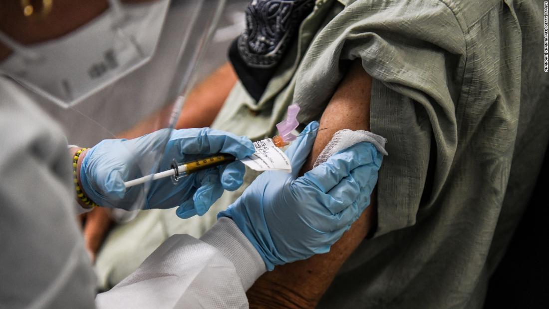 A man receives an injection while taking part in a vaccine trial in Hollywood, Florida, on August 13.