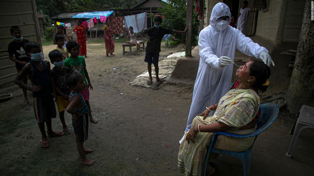 A health worker administers a Covid-19 test in the Indian village of Kusumpur on Monday, August 17.