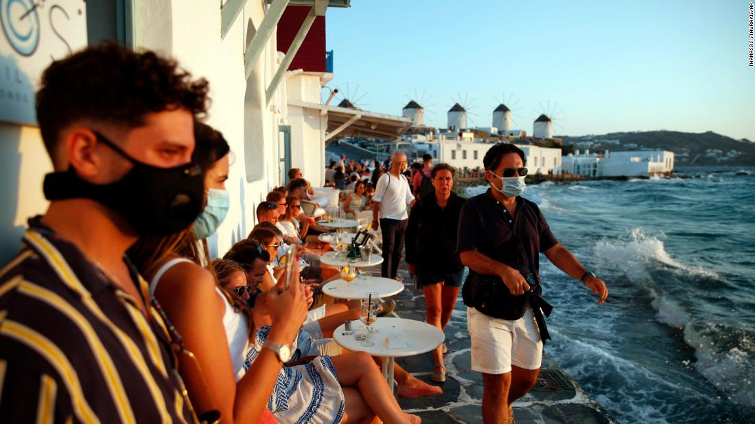 People gather in Little Venice on the Aegean Sea island of Mykonos, Greece, on August 16.