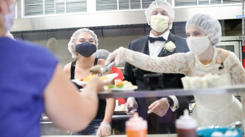 Ohio newlyweds turned their canceled reception into an act of service by donating their reception food to a local women's shelter.
