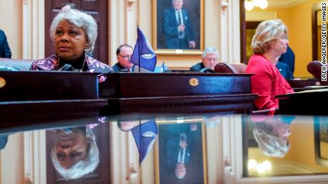L. Louise Lucas, left, listens to the proceedings on the Senate floor at the Virginia State Capitol, February 7, 2019 in Richmond, Virginia.