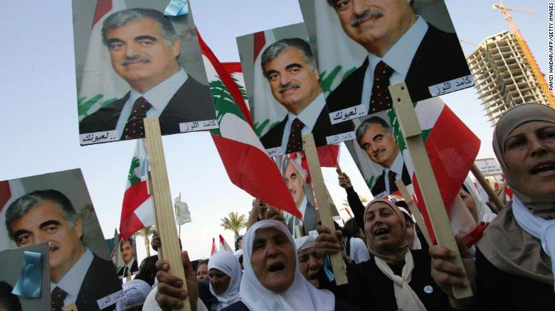 Lebanese women holding posters of Hariri march in Beirut in March 2005.