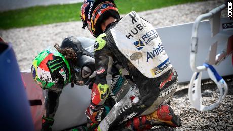 Johann Zarco checks on Franco Morbidelli after the crash.