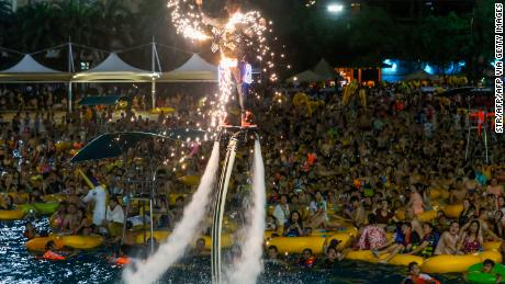 A performer entertains the crowds at Wuhan's Maya Beach Water Park.