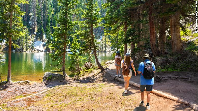 It's the right time to hike. One good spot is Emerald Lake Trail, next to Dream Lake, Rocky Mountains National Park in Colorado.