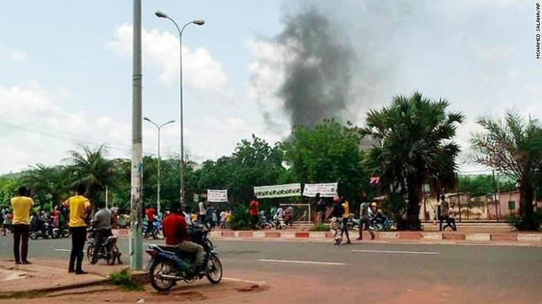 Smoke rises from the residence of Mali's finance minister Kassim Tapo in Bamako on Aug. 18, 2020.