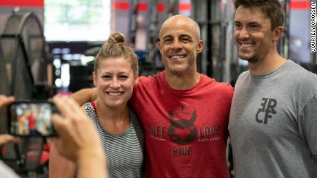 Eric Roza, center, opened his CrossFit gym in 2012, and said it's been a longtime ambition to run the company.