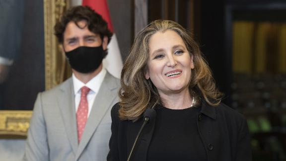 Finance Minister Chrystia Freeland smiles as she responds to a question as Prime Minister Justin Trudeau looks on during a news conference on parliament hill in Ottawa on Tuesday.