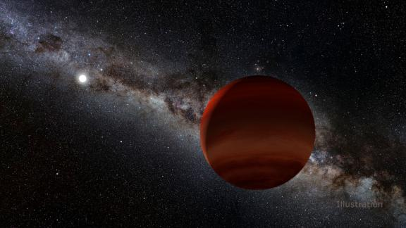 This artist's concept shows a brown dwarf, which is neither a planet nor a star, and a white dwarf, or dead star, in the distance.