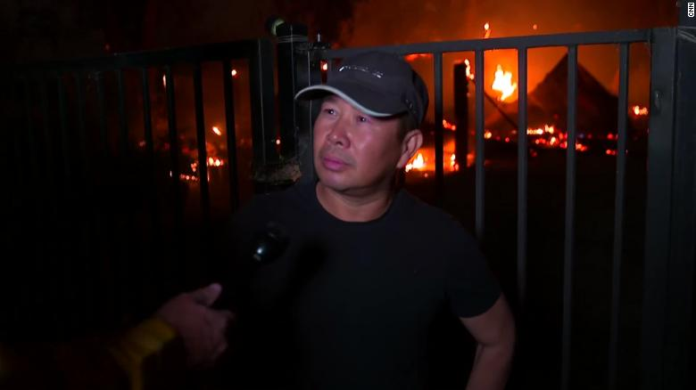 Thuy Ngo stands in front of his burning barn Wednesday near Vacaville.