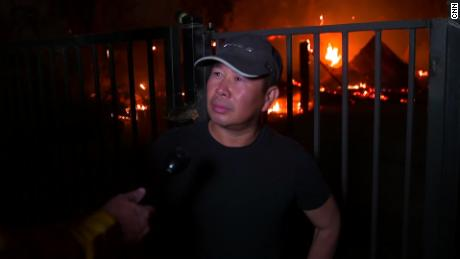 Thuy Ngo stands Wednesday in front of his burning barn near Vacaville.