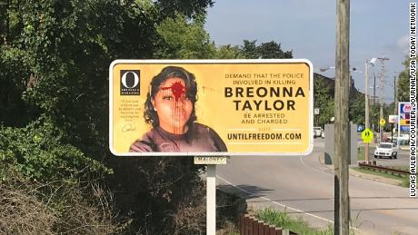 Someone threw red paint on a billboard for Breonna Taylor on Tuesday in Louisville, Kentucky. The sign was cleaned or replaced later that day.